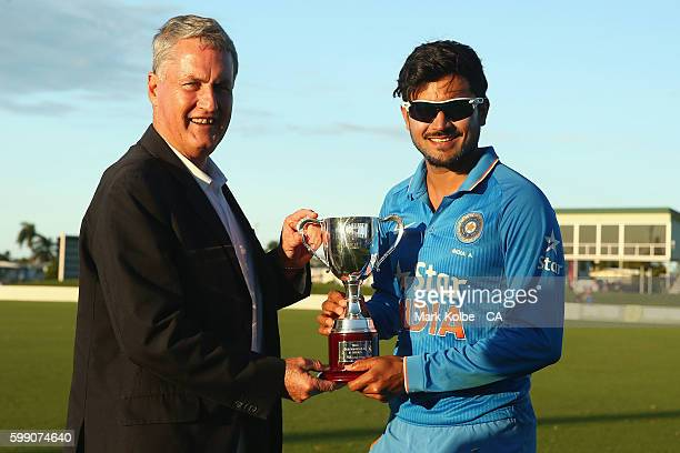 Greg Williamson the Mayor of Mackay Regional Council poses with India A captain Manish Pandey after presenting the trophy during the Cricket...