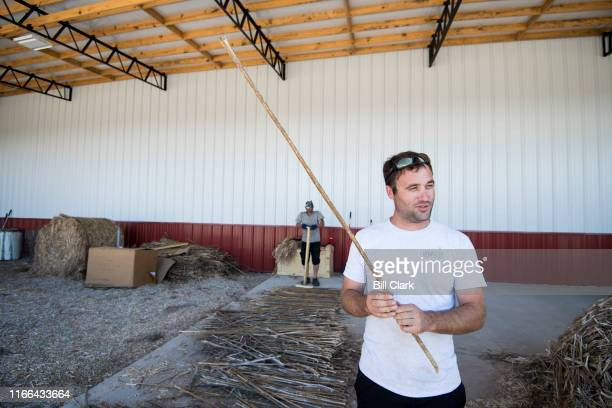 Greg Wilson describes the process of using hemp stalks to make flooring at his HempWood facility in Murray Ky on Thursday Sept 5 2019