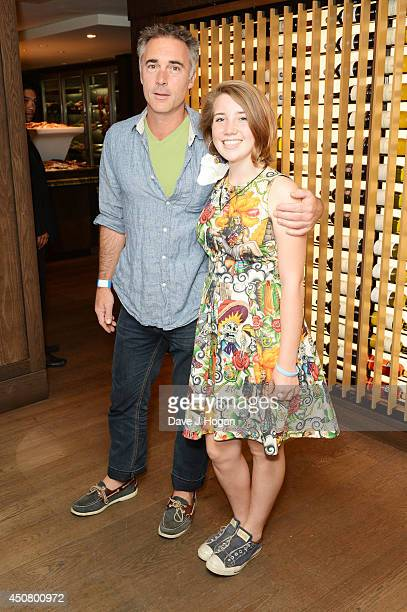 Greg Wise and Gaia Romilly Wise attend a special screening of 'The Fault In Our Stars' at The Mayfair Hotel on June 17 2014 in London England