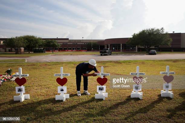 Greg Zanis lines up crosses he built in front of Santa Fe High School on May 21 2018 in Santa Fe Texas The crosses are a memorial to the victims of...