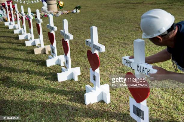 Greg Zanis lines up his crosses for the victims of the Santa Fe High School shooting in front of the high school on May 21 2018 in Santa Fe Texas
