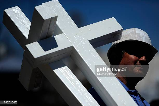 Greg Zanis of Aurora Illinois carries crosses for a memorial for the victims of the Aurora Theater Shooting at the intersection of Sable Boulevard...
