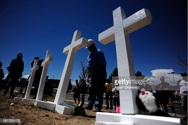 Greg Zanis of Aurora Illinois takes a moment at a memorial for the victims of the Aurora Theater Shooting after he placed the final one of 12 at the...