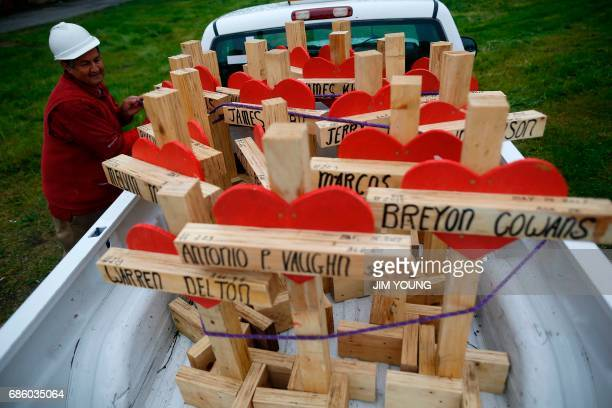 Greg Zanis ties down wooden crosses in the back of his truck after a planned prayer vigil and rally against violence in Chicago Illinois on May 20...