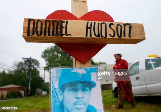 Greg Zanis walks past a wooden cross at a planned prayer vigil and rally against violence in Chicago Illinois on May 20 2017 Zanis makes a...