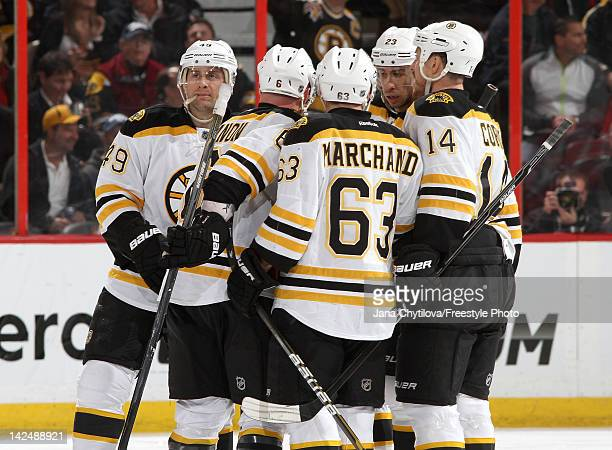 Greg Zanon of the Boston Bruins celebrates his second period goal with teammates Rich Peverley Brad Marchand Chris Kelly and Joe Corvo during an NHL...