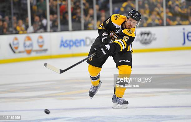Greg Zanon of the Boston Bruins passes the puck against the Washington Capitals in Game Seven of the Eastern Conference Quarterfinals during the 2012...