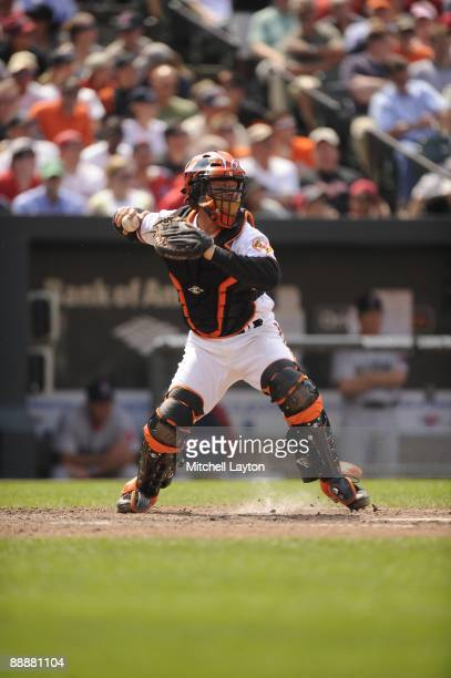 Greg Zaun of the Baltimore Orioles throws to second base during a baseball game against the Boston Red Sox on July 1 2009 at Camden Yards in...