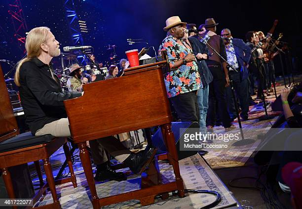 Gregg Allman and Taj Mahal perform during All My Friends Celebrating the Songs Voice of Gregg Allman at The Fox Theatre on January 10 2014 in Atlanta...