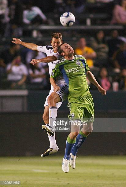 Gregg Berhalter of the Los Angeles Galaxy competes for the ball in the air with Pat Noonan of the Seattle Sounders FC on July 4 2010 at the Home...