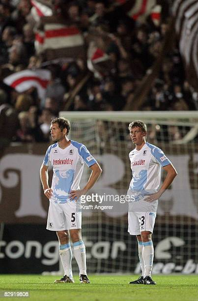 Gregg Berhalter and Benjamin Schwarz of Muenchen look dejected after the Second Bundesliga match between FC St Pauli and TSV 1860 Muenchen at the...