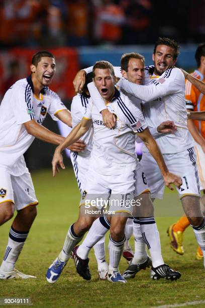 Gregg Berhalter of the Los Angeles Galaxy celebrates scoring the go ahead goal with teammates against the Houston Dynamo during their MLS Western...