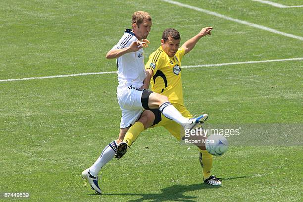 Gregg Berhalter of the Los Angeles Galaxy fights for control of the ball against Alejandro Moreno of the Columbus Crew during their MLS game at The...