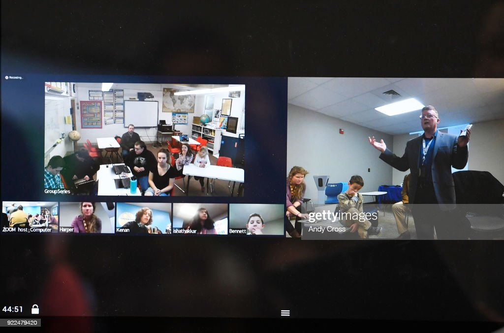 Gregg Cannady, right, Collaboration and Concept Development teacher at STEM Highlands Ranch, along with his students at Highlands Ranch, lower left, interact with Arickaree High School students, left, during a class via high-tech video conferencing equipment, which includes a 360 camera February 21, 2018.