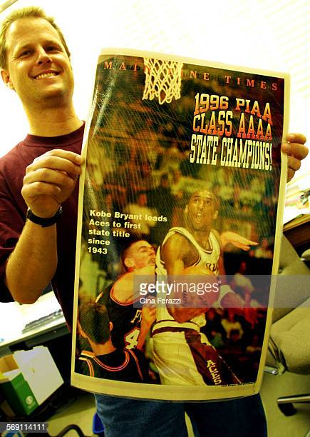 Gregg Downer old high school coach of Laker superstar Kobe Bryant holds the full page color newspaper cover of Kobe Bryant during the 1996 State...