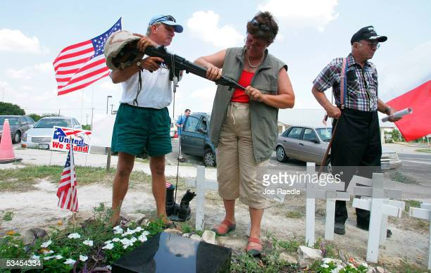 Gregg Garvey from Keystone Heights Florida who lost his son Sergeant Justin Garvey in Iraq and Julie CurtisWin work on putting a M16 rifle on a...