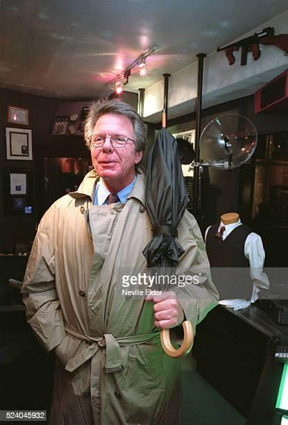 Gregg Graison wears a bulletproof raincoat and carries a bulletproof umbrella Graison is Senior Vice President of Quark International Ltd a 'spy...