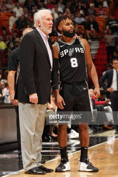 Gregg Popovich and Patty Mills of the San Antonio Spurs talk during the game against the Miami Heat on October 25 2017 at AmericanAirlines Arena in...