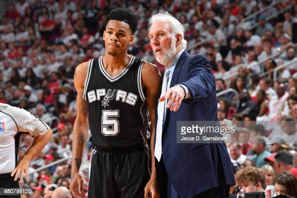 Gregg Popovich coaches Dejounte Murray of the San Antonio Spurs in Game Four of the Western Conference Semifinals against the Houston Rockets during...