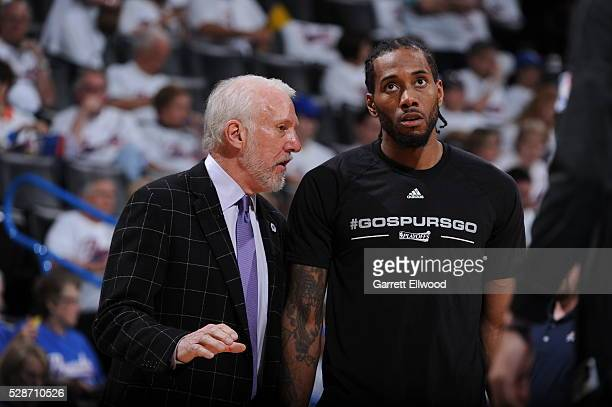 Gregg Popovich coaches Kawhi Leonard of the San Antonio Spurs during the game against the Oklahoma City Thunder in Game Three of the Western...