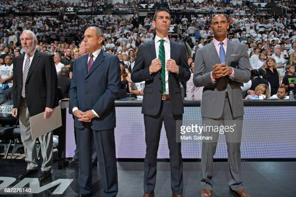 Gregg Popovich Ettore Messina James Borrego and Ime Udoka of the San Antonio Spurs look on before Game Three of the Western Conference Finals against...