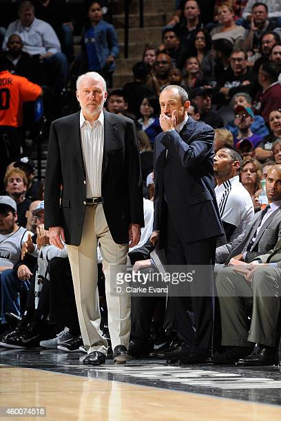 Gregg Popovich Head Coach of the San Antonio Spurs and Assistant Coach Ettore Messina stand on the court during a game against the San Antonio Spurs...