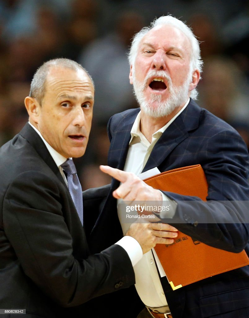 Gregg Popovich head coach of the San Antonio Spurs is restrained by assistant coach Ettore Messina after receiving his second technical during game against the Dallas Mavericks at AT&T Center on November 27, 2017 in San Antonio, Texas.