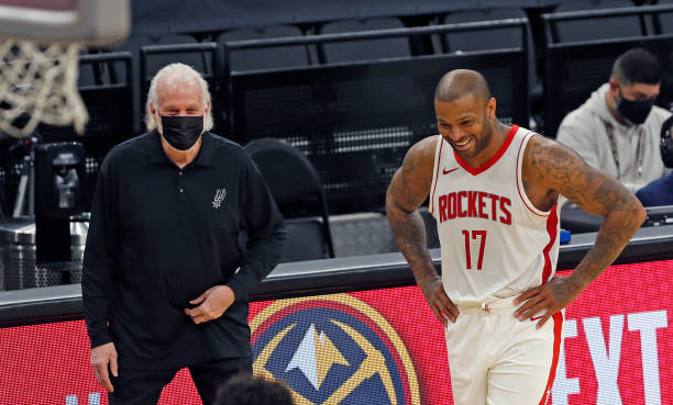 Gregg Popovich head coach of the San Antonio Spurs shares a light moment with PJ Tucker of the Houston Rockets at AT&T Center on January 14, 2021 in...