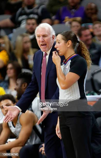 Gregg Popovich head coach of the San Antonio Spurs talks with official Ashley MoyerGleich during game against the Los Angeles Lakers at ATT Center on...