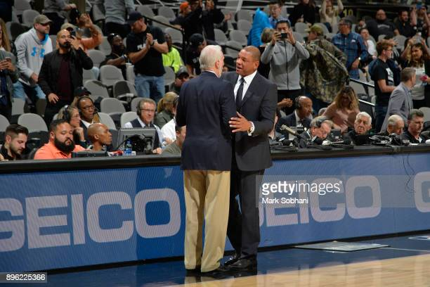 Gregg Popovich of the San Antonio Spurs and Doc Rivers of the LA Clippers talk after the game on December 18 2017 at the ATT Center in San Antonio...