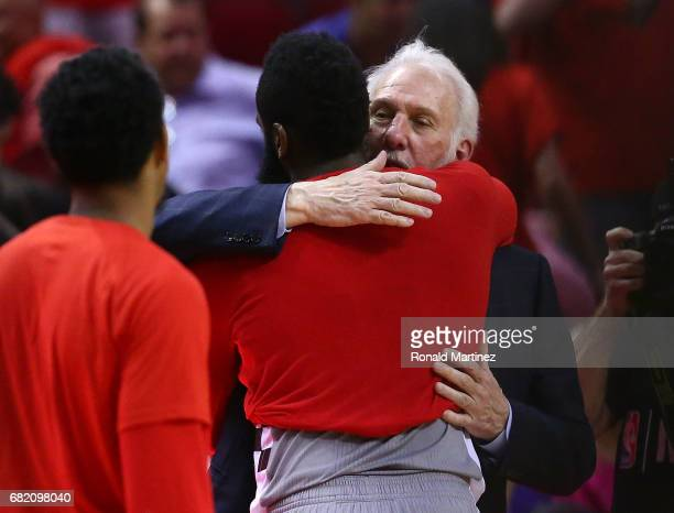 Gregg Popovich of the San Antonio Spurs hugs James Harden of the Houston Rockets after their 11475 win during Game Six of the NBA Western Conference...