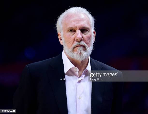 Gregg Popovich of the San Antonio Spurs looks on during the first half against the LA Clippers at Staples Center on February 24 2017 in Los Angeles...