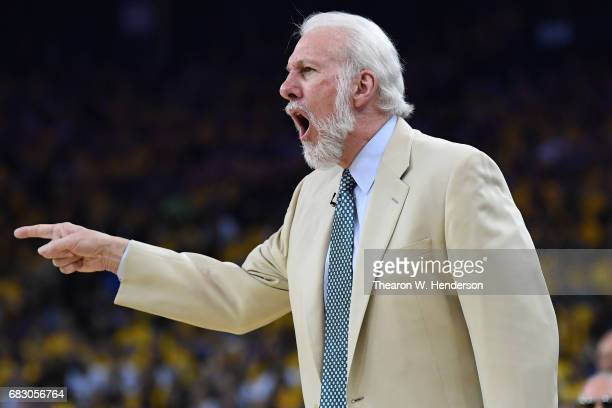 Gregg Popovich of the San Antonio Spurs signals to his team during Game One of the NBA Western Conference Finals against the Golden State Warriors at...