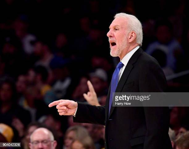 Gregg Popovich of the San Antonio Spurs talks to his players from the sidelines during the first half against the Los Angeles Lakers at Staples...