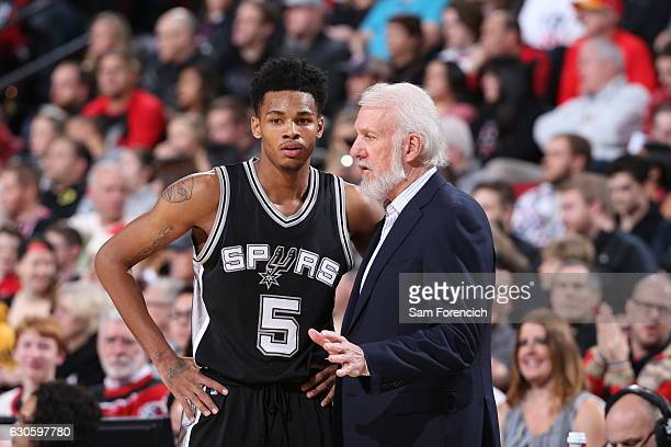 Gregg Popovich of the San Antonio Spurs talks with Dejounte Murray of the San Antonio Spurs during the game against the Portland Trail Blazers on...