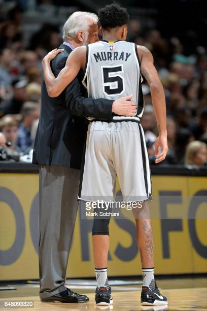 Gregg Popovich of the San Antonio Spurs talks with Dejounte Murray of the San Antonio Spurs during the game against the Minnesota Timberwolves on...