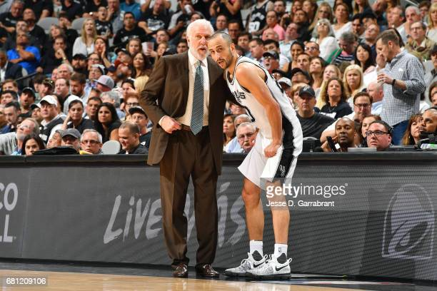 Gregg Popovich of the San Antonio Spurs talks with Manu Ginobili of the San Antonio Spurs during the game against the Houston Rockets during Game...