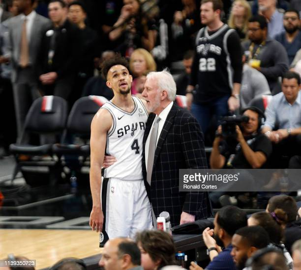 Gregg Popvich head coach of the San Antonio Spurs consoles Derrick White after a foul against the Denver Nuggets sduring Game Six of the first round...