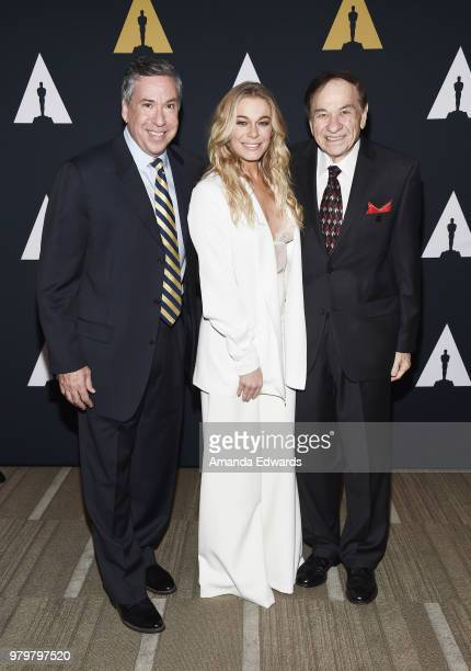 Gregg Sherman singer LeAnn Rimes and songwriter Richard M Sherman arrive at The Academy Of Motion Picture Arts And Sciences presentation of The...