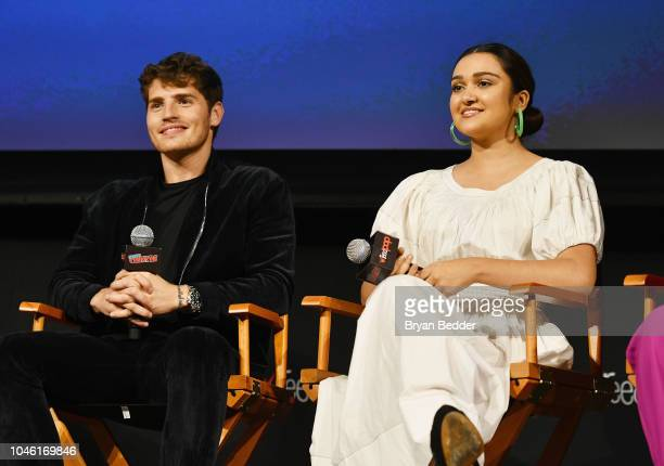 Gregg Sulkin and Ariela Barer speak onstage during Hulu's 'Runaways' panel at 2018 New York Comic Con at The Theater at Madison Square Garden on...