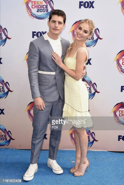Gregg Sulkin and Michelle Randolph arrive on the blue carpet at TEEN CHOICE 2019 airing Sunday August 11 on FOX from Hermosa Beach CA
