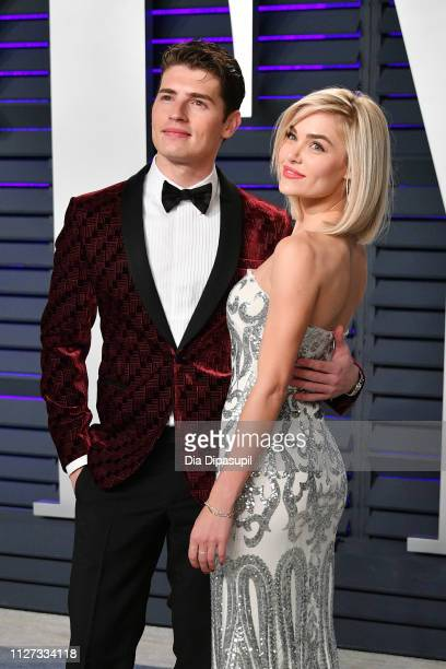 Gregg Sulkin and Michelle Randolph attend the 2019 Vanity Fair Oscar Party hosted by Radhika Jones at Wallis Annenberg Center for the Performing Arts...