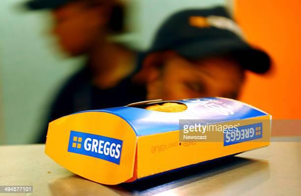 A Greggs the Baker employee serving a customer