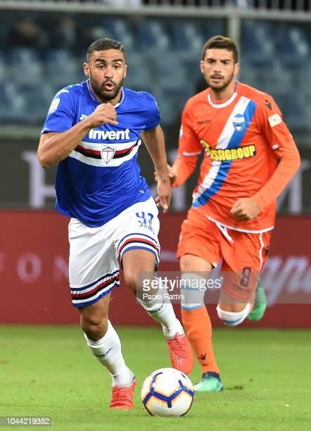 Gregoire Defrel of Sampdoria and Mattia Valoti of Spal during the Serie A match between UC Sampdoria and SPAL at Stadio Luigi Ferraris on October 1...