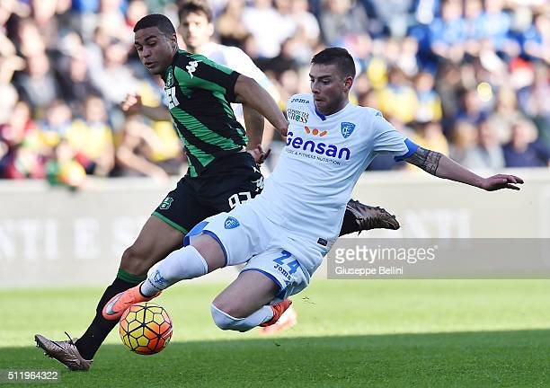 Gregoire Defrel of Sassuolo and Uros Cosic of Empoli in action during the Serie A match between US Sassuolo Calcio and Empoli FC at Mapei Stadium...