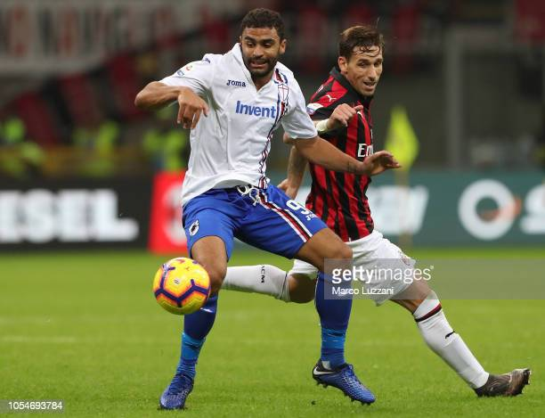Gregoire Defrel of UC Sampdoria competes for the ball with Lucas Biglia of AC Milan during the Serie A match between AC Milan and UC Sampdoria at...