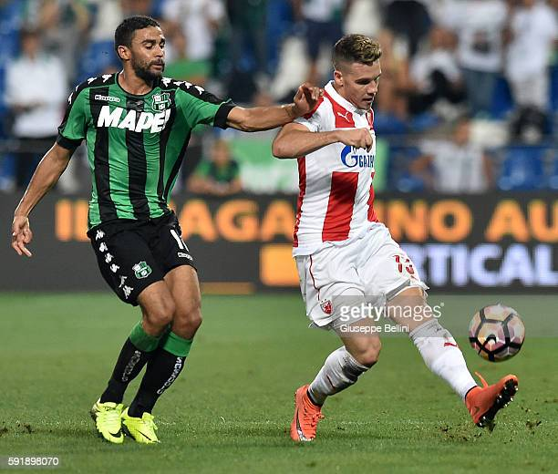 Gregoire Defrel of US Sassuolo and Mihailo Ristic of Fk Crvena Zvezda in action during the UEFA Europa League playoff match between US Sassuolo and...