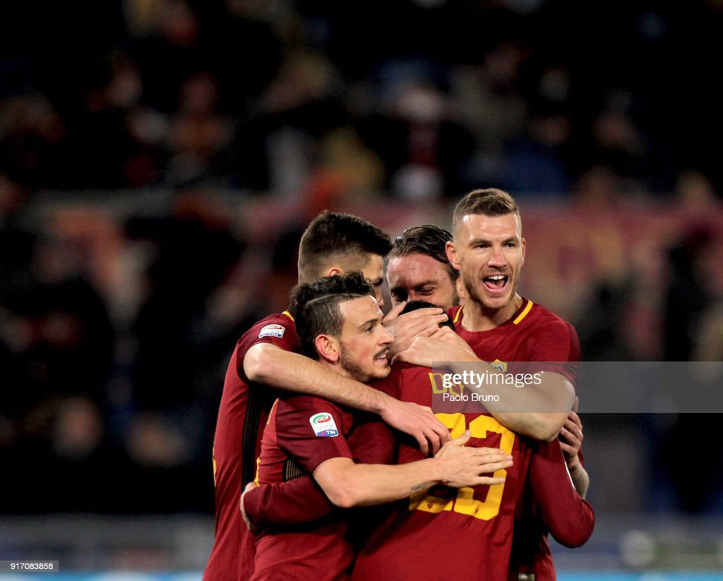 Gregoire Defrel with his teammates of AS Roma celebrate during the serie A match between AS Roma and Benevento Calcio at Stadio Olimpico on February 11, 2018 in Rome, Italy.