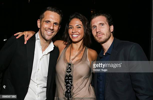 Gregoire Vogelsang Ana Lucia Souza and Ligas Yianni attend the Cube Art Fair Intimate New York Party September 1 2016 in New York City