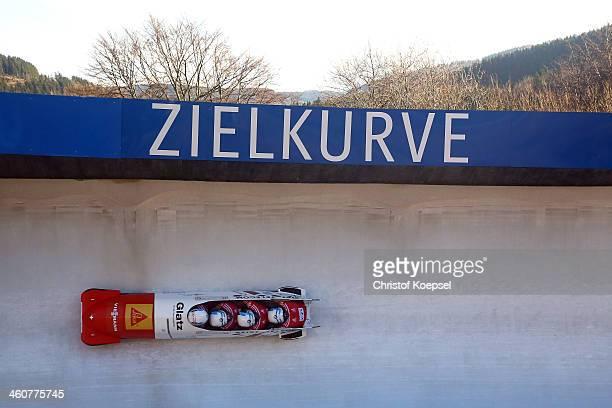 Gregor Baumann, Patrick Bloechliger, Fabio Badraun and Simon Friedli of Switzerland compete in their first run of the four man bob competition during...